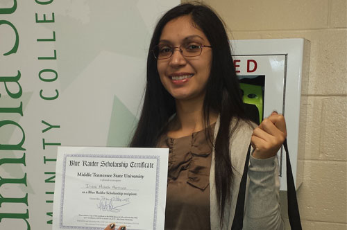 Iliana with scholarship certificate